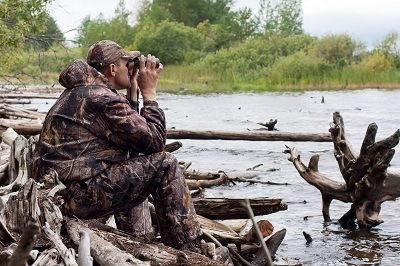 Hunter Looking through Hunting Binoculars for Prey