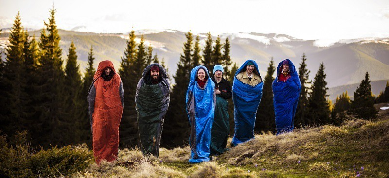 Group On Camping Trip With Lightweight Ultralight Sleeping Bag
