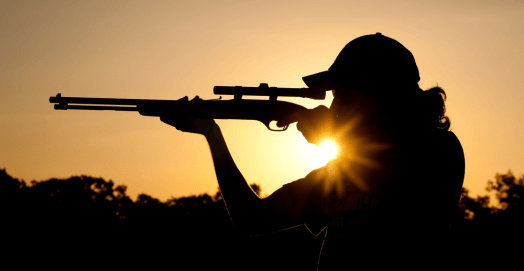 man with bolt action rifles
