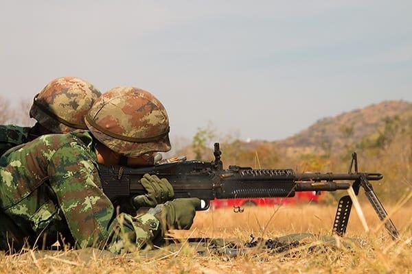 soldier firing a heavy gun