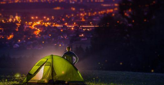 man camping on a countryside