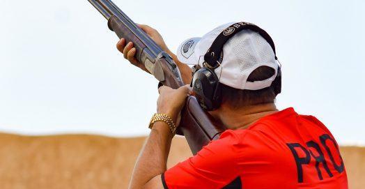 man using a shooting gun