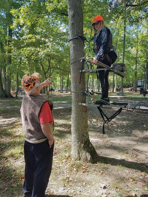 women learning how to use tree stand
