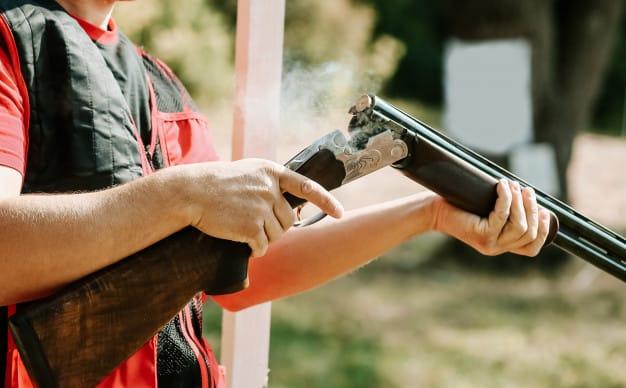 man opens shotgun bolt
