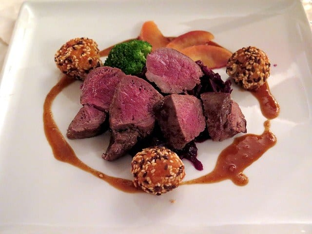 a plate of venison dish