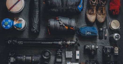 camera and gear packed for camping