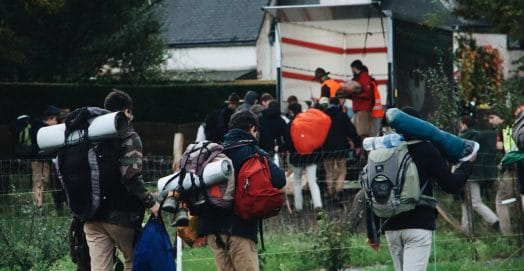 photo-of-people-bringing-backpack